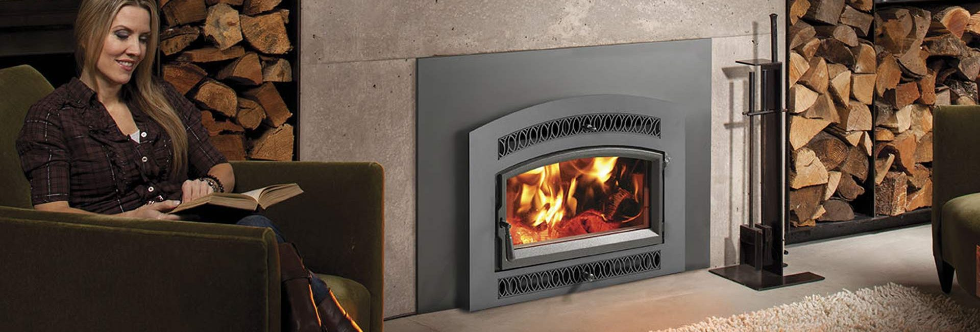 Woman reading by fireplace