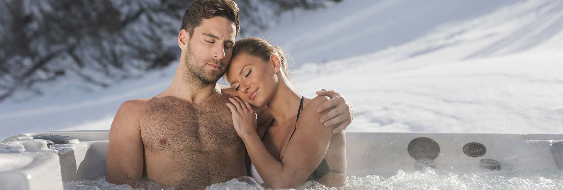 A couple relaxing in their hot tub
